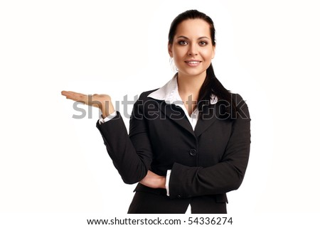 A young beautiful business woman pointing at copyspace