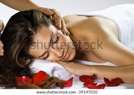 a young beautiful girl is being massaged