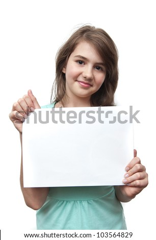 A young beautiful teen girl with the paper in hand looking at camera
