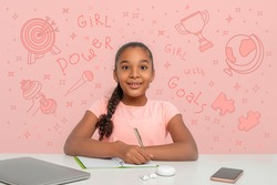 A young black African girl with a rapturous look is writing down her goals in a notebook.  Doodle about powers of the girl are drawn on the pink background. Happy childhood concept