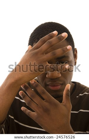 A young black man hiding his face with the hands