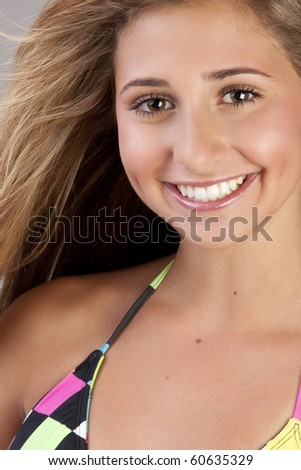 a young blond pretty teenage girl up close. - stock photo