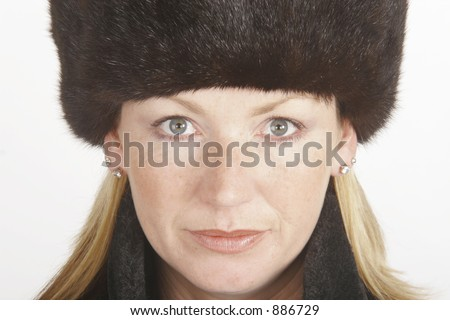 A young blonde woman in a Russian style fur hat and coat