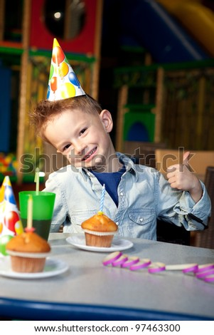 a young boy celebrating birthday