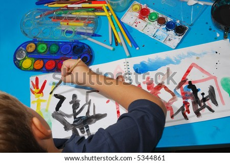 A young boy draws a picture