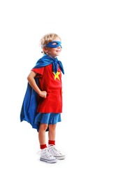 A young boy dreams of becoming a superhero, white background