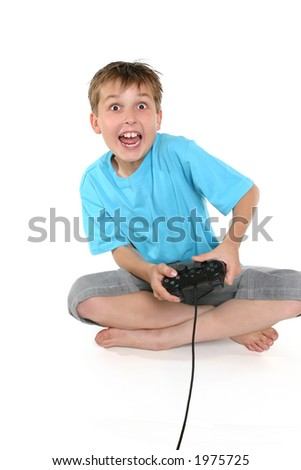 A young boy enjoying a computer game.