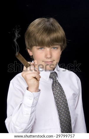 A young boy in a dress shirt and tie smokes a cigar as if living a high society lifestyle. Good for any business inference and for health smoking issues.