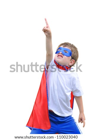 A young boy is dressed up as a superhero and pointing up with a mask and cape. There is a white isolated background. Use it for a strength or halloween concept.