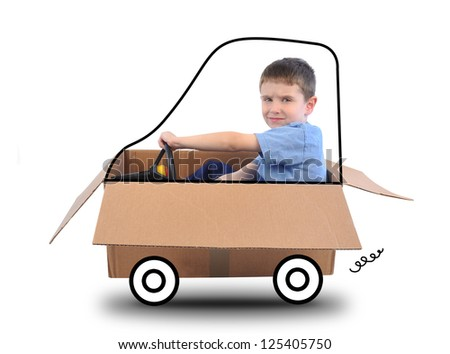 A young boy is driving a box car with a wheels thar are drawn and he is holding a steering wheel on a white background.
