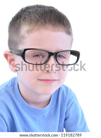 A young boy is wearing a pair of glasses and is thinking with an isolated white background for an education or learning concept.