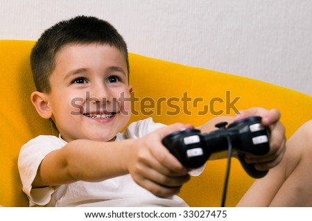 A young boy playing a computer game.