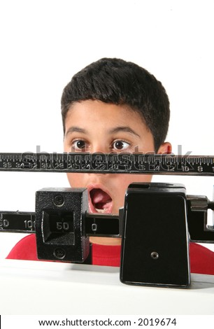 A young boy showing his surprise at his weight