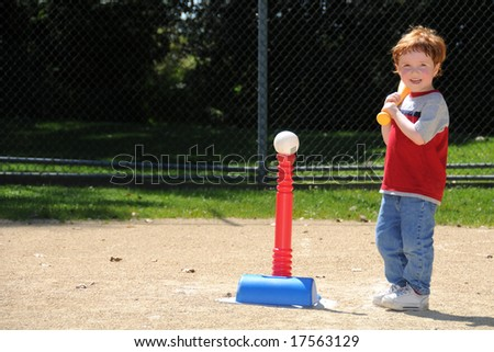 A young boy steps up to bat during t-ball practice at a neighborhood softball diamond.