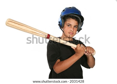 A young boy swinging the bat in a game of baseball