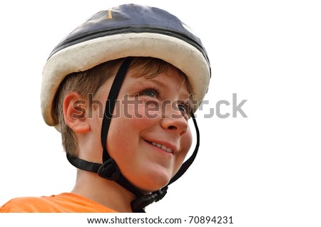 A young boy wearing his bike helmet, ready to ride.