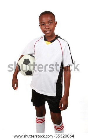 A young boy with a soccer ball. isolated on white