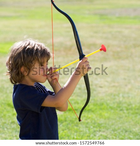 A young boy with a toy bow and arrow