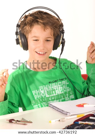 A young boy with headphones listening to music