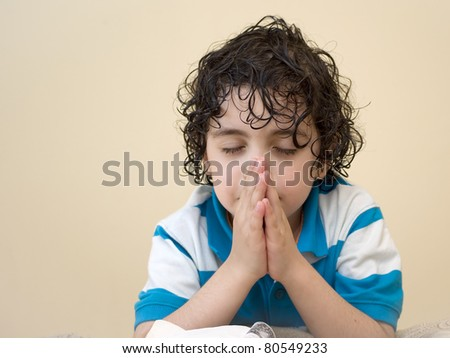 A young boys prays to his creator in heaven. Religious Concept.