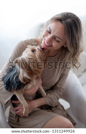 A young Brazilian woman at home with her silky terrier #1311249926