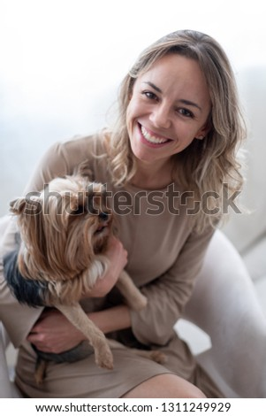 A young Brazilian woman at home with her silky terrier #1311249929