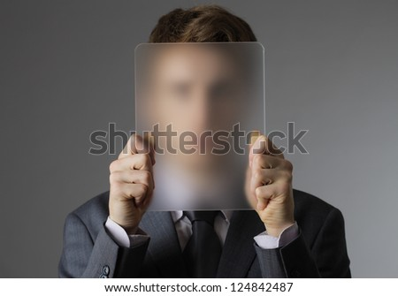 A Young business man covering his face