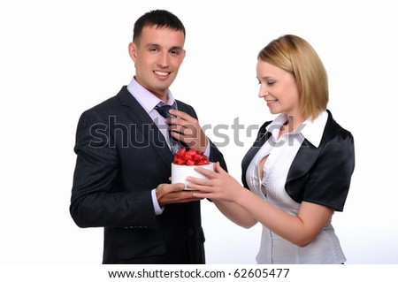 A young business man presents his gift to a colleague