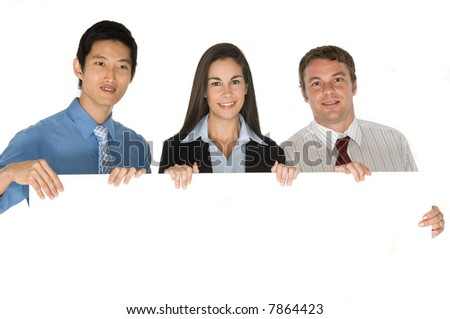 A young business team holding a blank board for your copy
