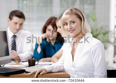 A young business team in the office - Shutterstock ID 72610666