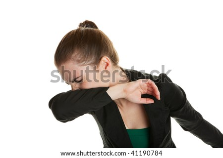 young business woman, sneezing into her sleeve to prevent spreading ...
