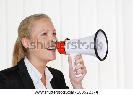 a young business woman with a megaphone making an announcement
