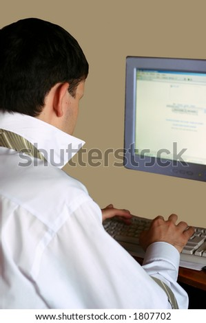 A young businessman browsing on internet (with clipping path).
