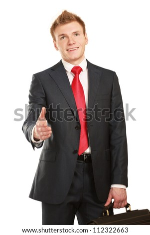 A young businessman giving his hand for a handshake - stock photo