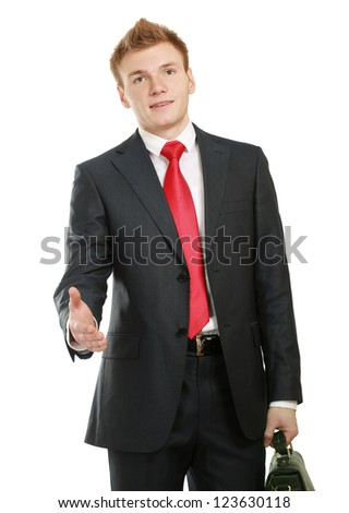 A young businessman giving his hand for a handshake, isolated on white background