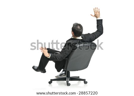 A young businessman in a chair isolated on a white background