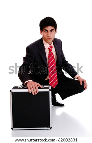 A young businessman is walking and holding a briefcase.