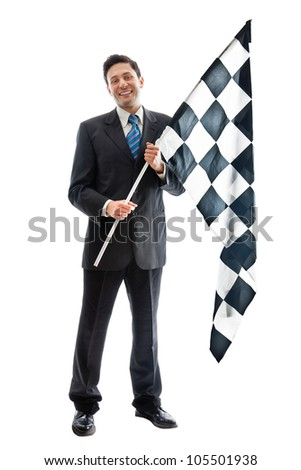 A Young Businessman isolated on a white background holding a checkered flag and smiling