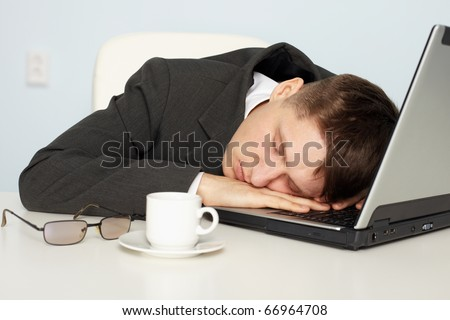 A young businessman not enough sleep and fell asleep on the job