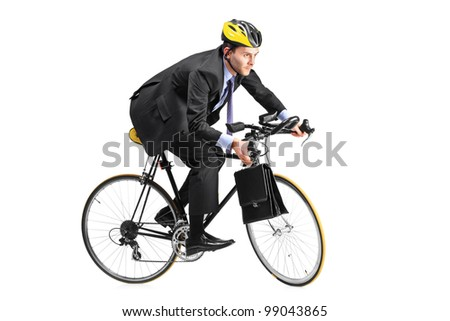 A young businessman riding a bicycle going towards his workplace isolated on white background - stock photo