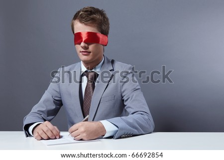 A young businessman signs a document with your eyes closed - stock photo