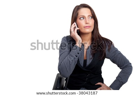 A young businesswoman in a dress is making a phone call - stock photo