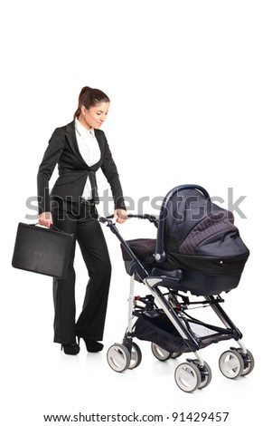 A young businesswoman pushing a baby stroller isolated against white background