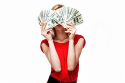 A young businesswoman with dollars in her hands isolated on white background