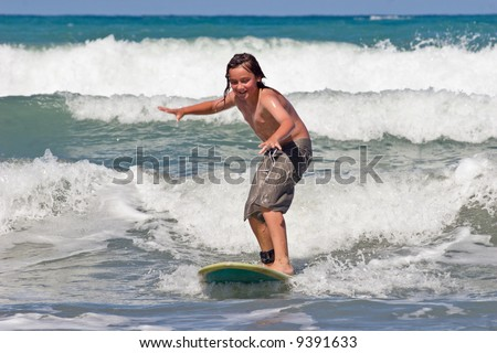 A young caucasian male learns to surf on Whangaehu Beach, Central Hawkes Bay, New Zealand