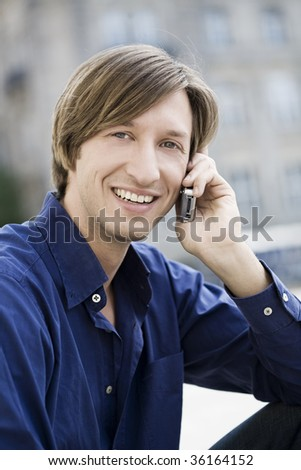 A young caucasian man with a nice shirt and straight hair