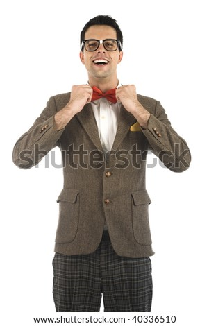 A young, caucasian nerd adjusting his bow-tie, isolated on a white background.