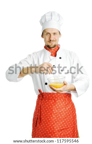 A young chef stirring something in a bowl