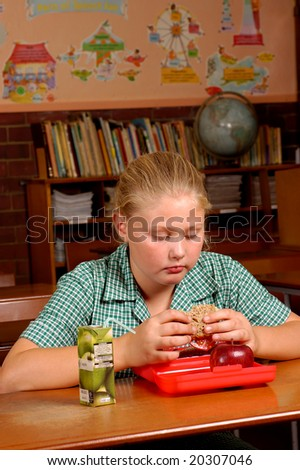 A young child eating her health lunch