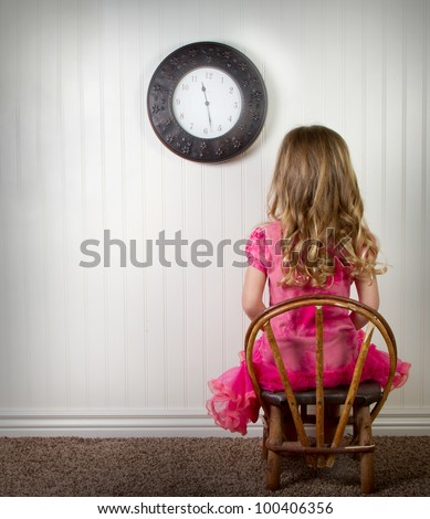 stock-photo-a-young-child-in-time-out-or-in-trouble-with-clock-on-wall-100406356.jpg